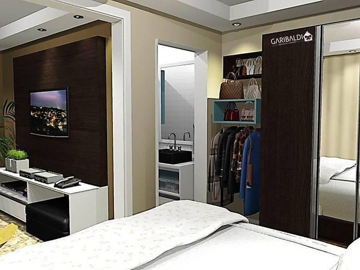Apartamento de um jovem casal : Quartos  por Garibaldi - Arquitetura . Interiores