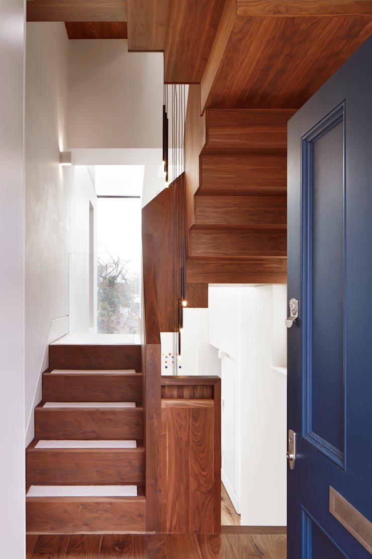 View  of the stairs from the front door :  Corridor & hallway by Fraher Architects Ltd