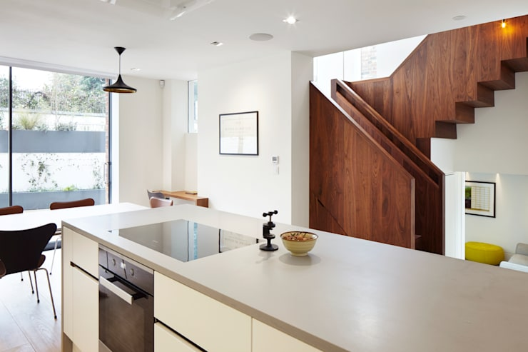 From the kitchen to the stairs:  Kitchen by Fraher Architects Ltd