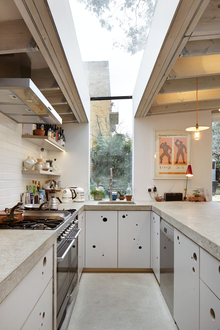 Wrap around window in the kitchen:  Kitchen by Fraher Architects Ltd