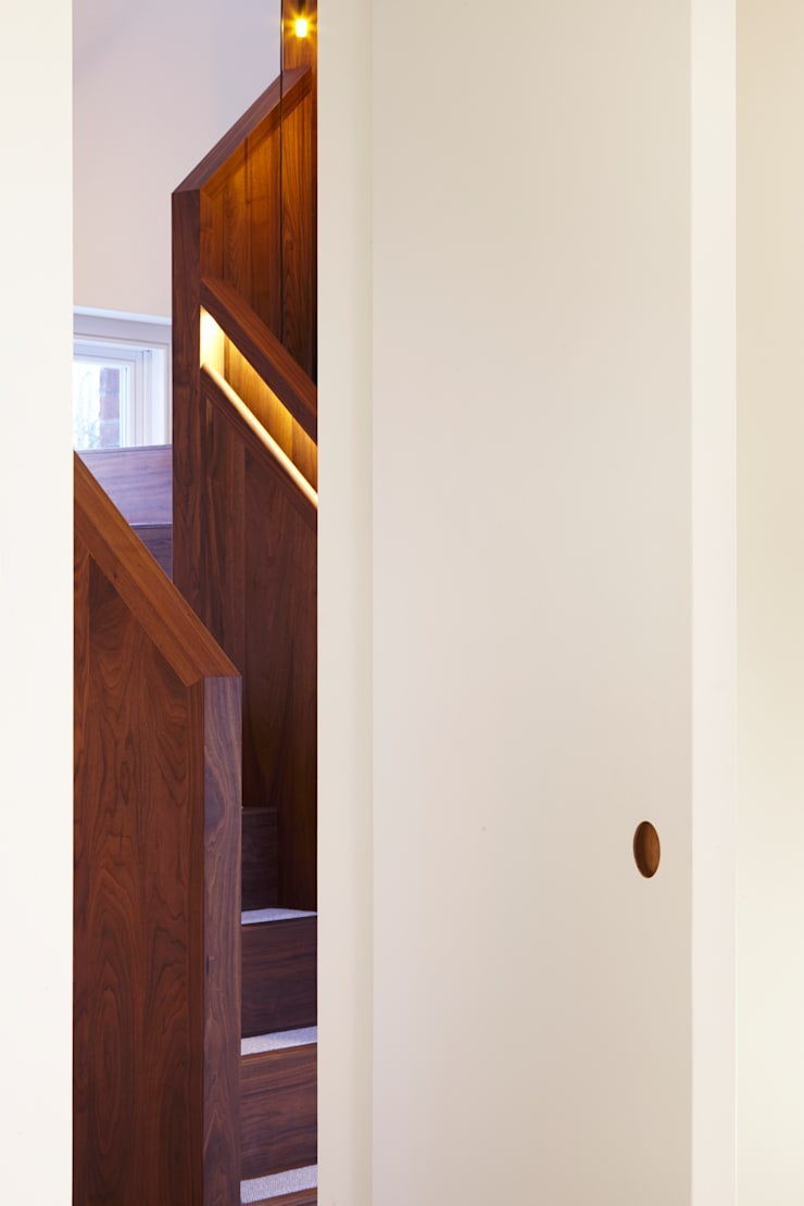 View through the internal full height doors to the stairs:  Corridor, hallway & stairs by Fraher Architects Ltd