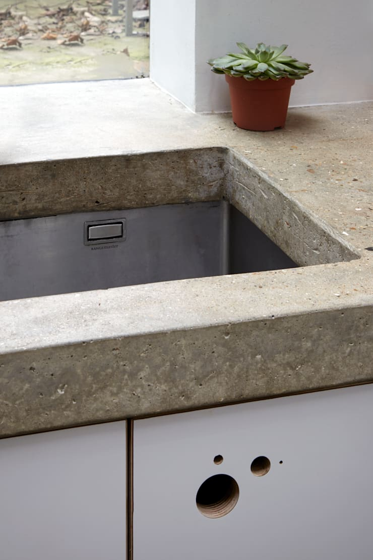 Sink within the concrete work top:  Kitchen by Fraher Architects Ltd