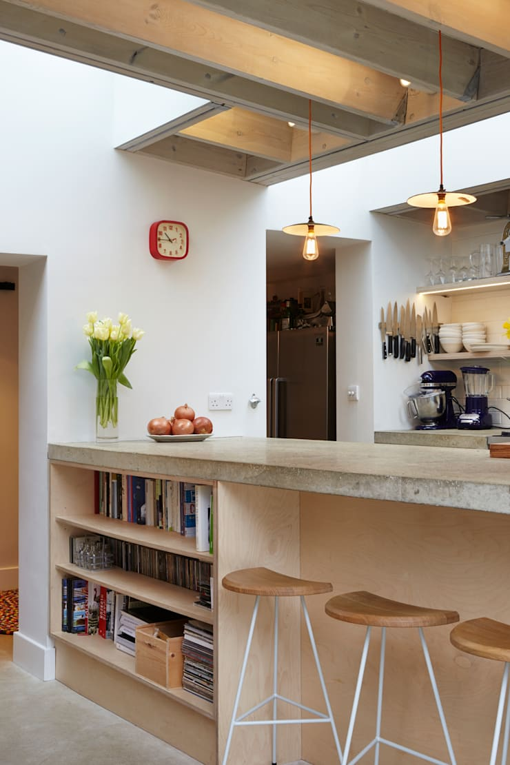 Shelving beneath the concrete work surface:  Living room by Fraher Architects Ltd