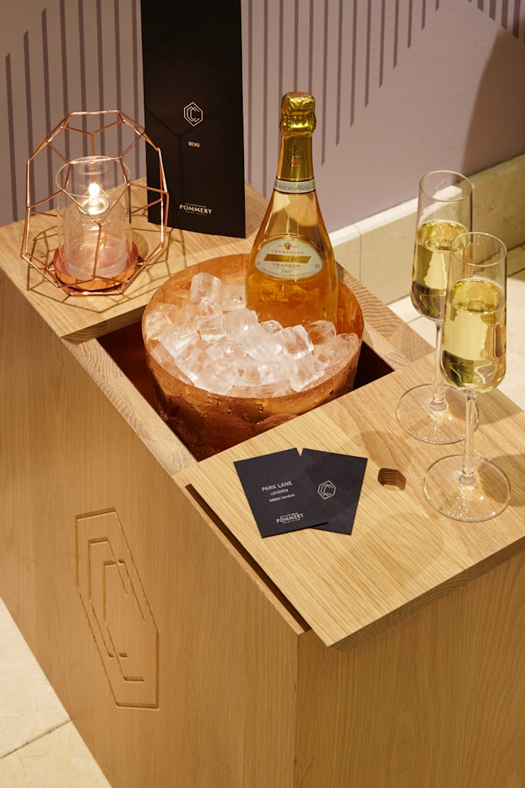 Champagne served in branded boxes:  Bars & clubs by Fraher Architects Ltd