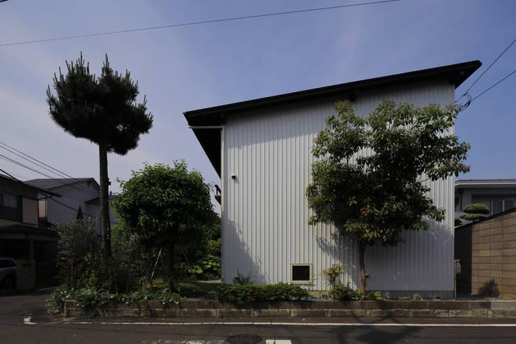 Casas ecléticas por 早田雄次郎建築設計事務所/Yujiro Hayata Architect & Associates