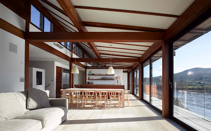 View from living to dining/kitchen spaces:   by John Pardey Architects