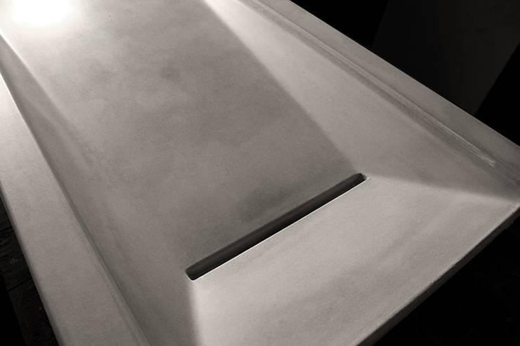 Asymmetrical Concrete Ramp Sink :  Bathroom by Forma Studios