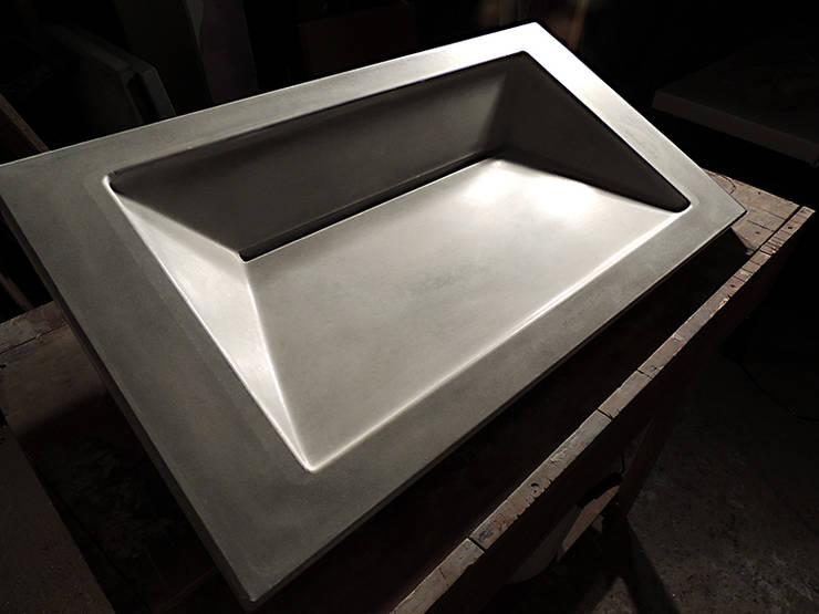 Symmetrical Concrete Ramp Sink :  Bathroom by Forma Studios