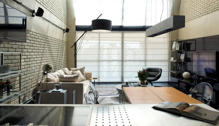 Living room by DIEGO REVOLLO ARQUITETURA S/S LTDA., Industrial