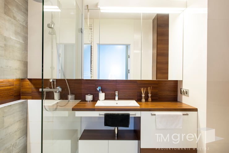 Bathroom by TiM Grey Interior Design,