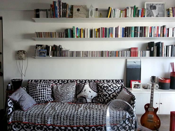 zona living: Soggiorno in stile  di studio radicediuno