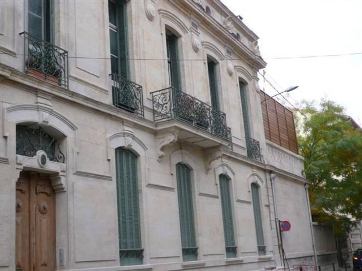 Façade de l'immeuble: Maisons de style  par AGENCE D'ARCHITECTURE BRAYER-HUGON