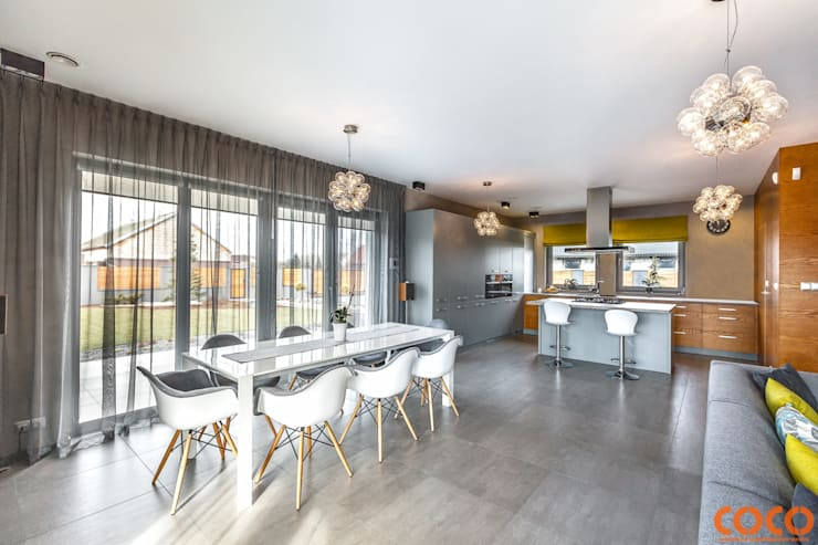 Dom w szarościach: styl , w kategorii Jadalnia zaprojektowany przez COCO Pracownia projektowania wnętrz