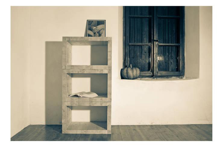 3 iO | libreria: Paesaggio d'interni in stile  di Margherita Mattiussi architetto