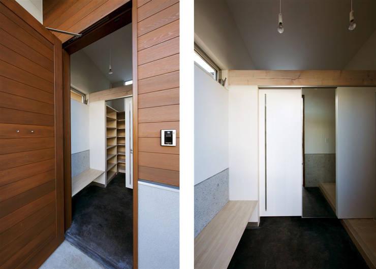 趣味の地下空間をもつコートハウス: 充総合計画 一級建築士事務所が手掛けた和室です。