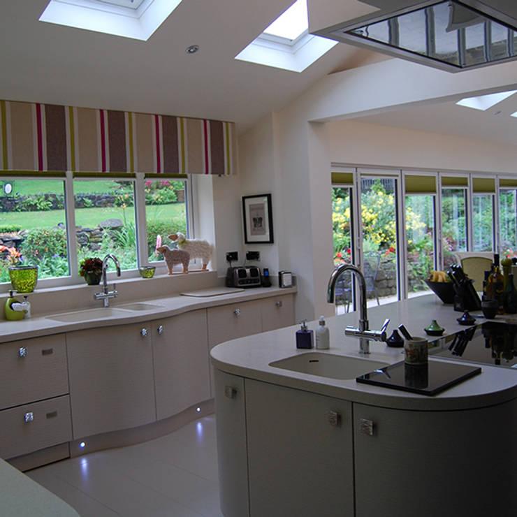 Bi-fold doors:  Kitchen by Nest Kitchens