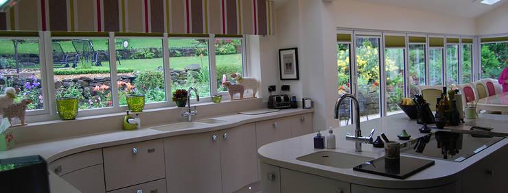 Corian worktops:  Kitchen by Nest Kitchens