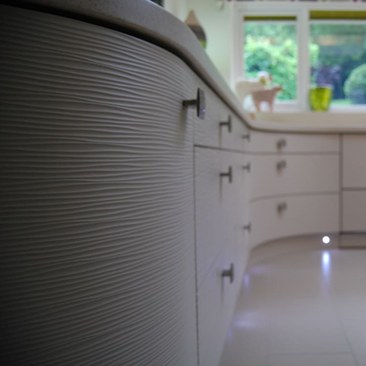 Curved textured door fronts:  Kitchen by Nest Kitchens