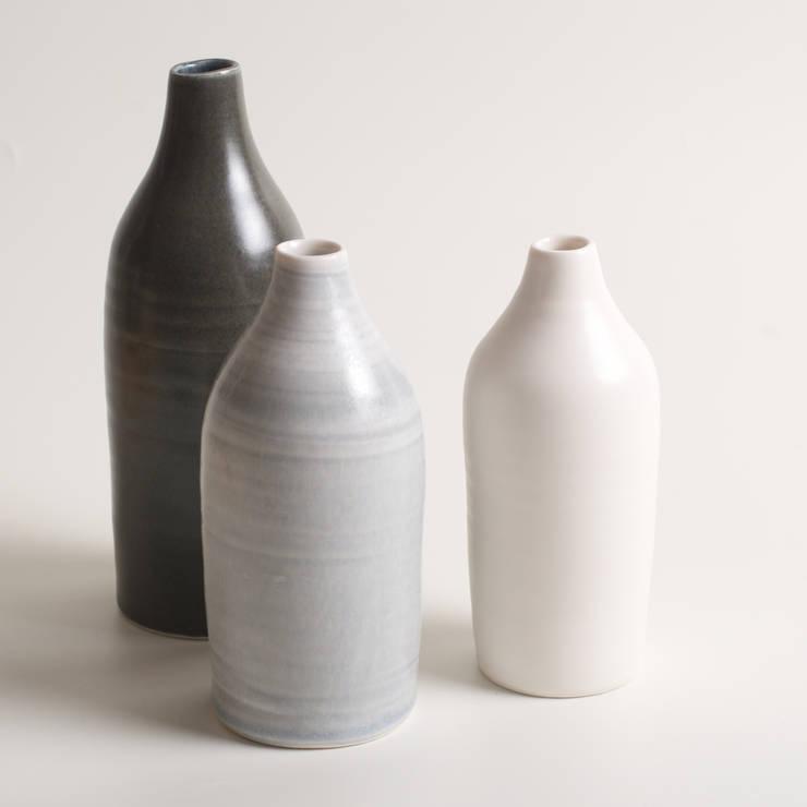 Handmade porcelain slim bottles:  Artwork by Linda Bloomfield