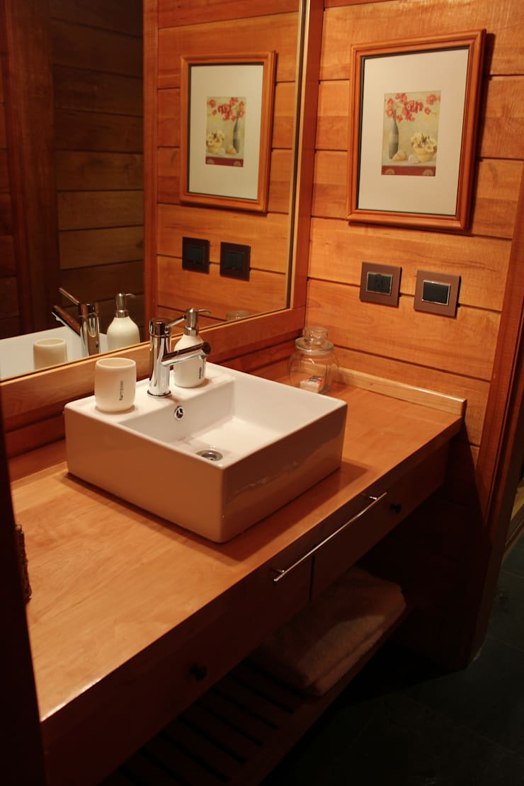 Casa Chapelco Golf and Resort – Patagonia Argentina: Baños de estilo  por Aguirre Arquitectura Patagonica