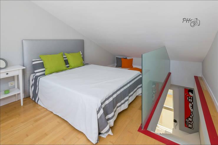 Buhardilla: Dormitorios de estilo moderno de Hansen Properties