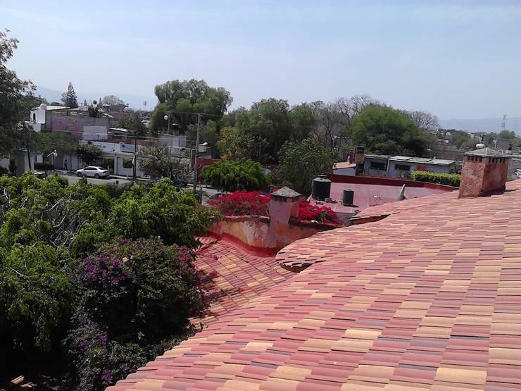 Casa Ala: Terrazas de estilo  por CONSTRUCTORA ARQOCE