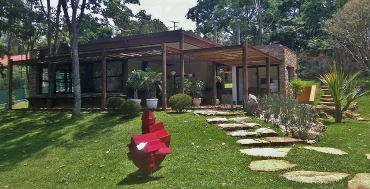 Casas de estilo rústico por Kika Prata Arquitetura e Interiores.