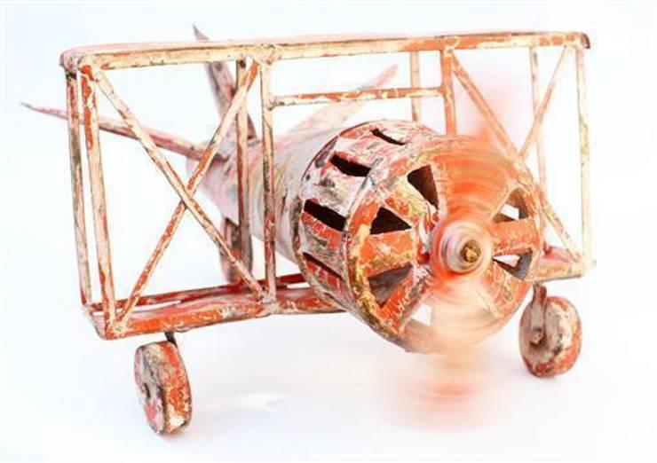Tin Toy Bi-plane Aeroplane:  Interior landscaping by Vintage Archive
