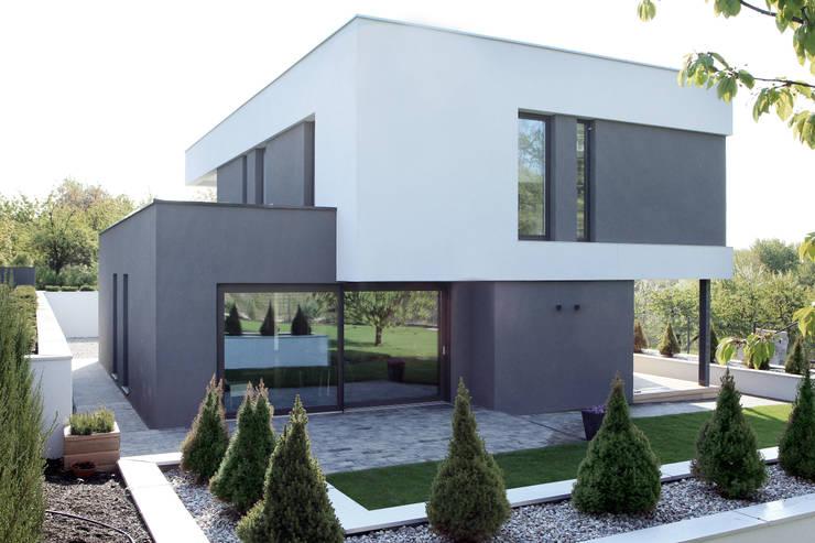 Casas de estilo moderno por STRUKTURA Łukasz Lewandowski