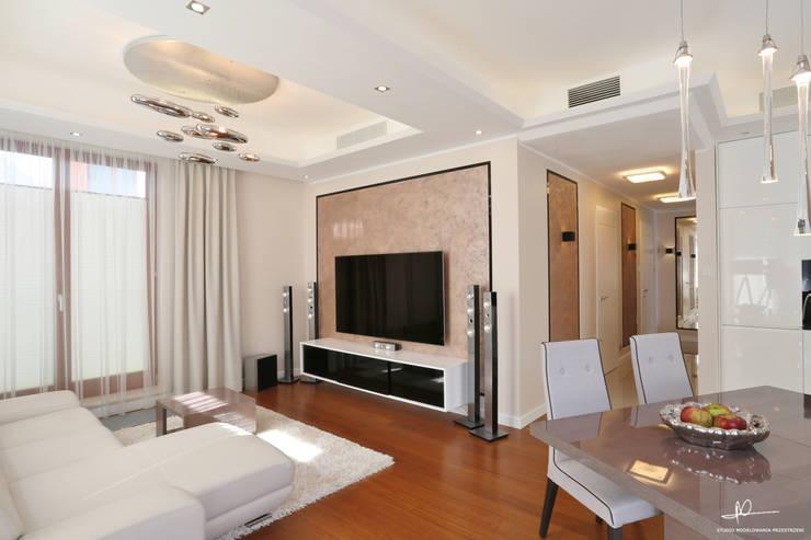 apartament w centrum miasta: styl , w kategorii Salon zaprojektowany przez Studio Modelowania Przestrzeni,Nowoczesny
