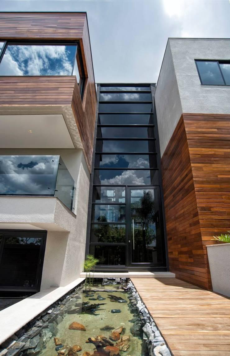 Projeto Casa Moderna - Jorge Elmor: Casas  por Elmor Arquitetura,
