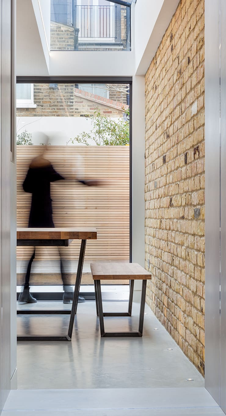 sliding glass:  Dining room by Thomas & Spiers Architects