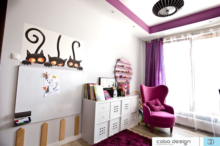 little girl and her cat: styl , w kategorii Pokój dziecięcy zaprojektowany przez Cobo Design