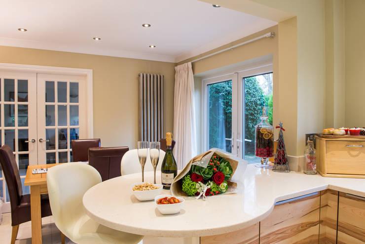 Modern German Kitchen - Kitchen Design Surrey:  Kitchen by Raycross Interiors