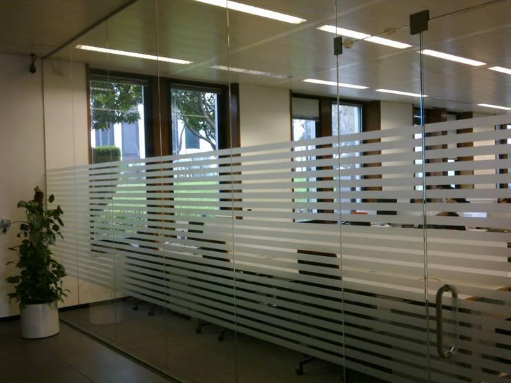 Escritórios Siemens: Escritórios  por Autovidreira