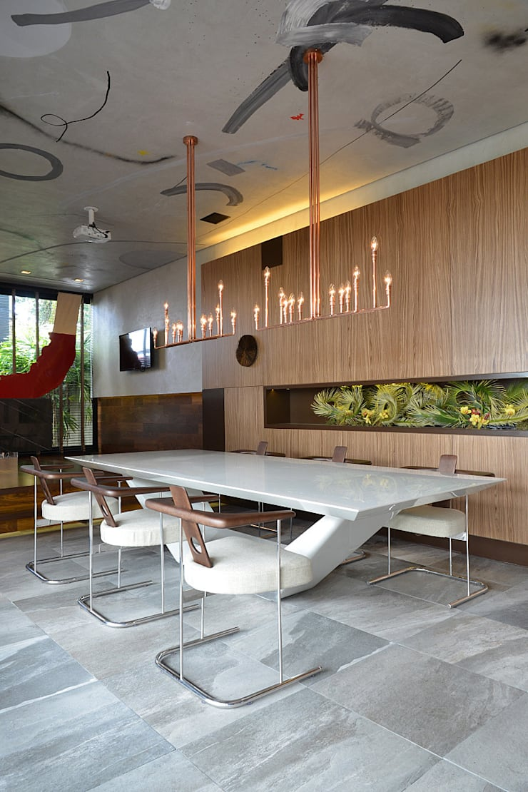 Espaço Cosmopolita - Jorge Elmor: Lojas e imóveis comerciais  por Elmor Arquitetura