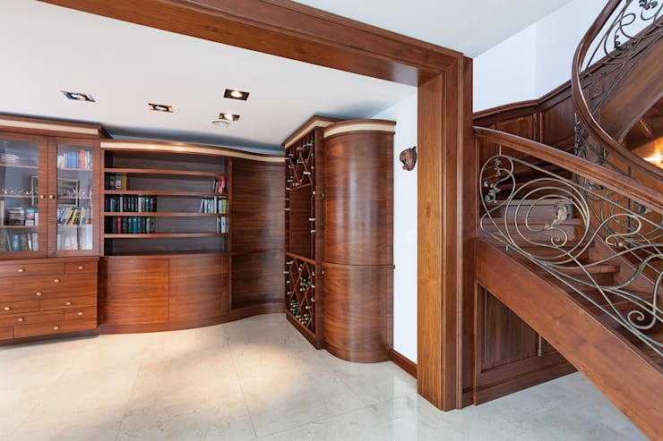 Anna Buczny PROJEKTOWANIE WNĘTRZ  Biblioteka realizacja Marchewka: styl , w kategorii Domowe biuro i gabinet zaprojektowany przez Anna Buczny PROJEKTOWANIE WNĘTRZ