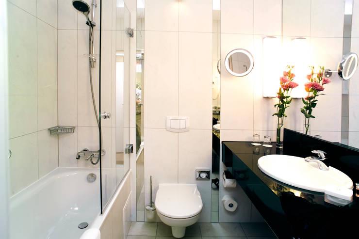 Anna Buczny PROJEKTOWANIE WNĘTRZ  Hotel Radisson BLU pokoje business: styl , w kategorii Hotele zaprojektowany przez Anna Buczny PROJEKTOWANIE WNĘTRZ