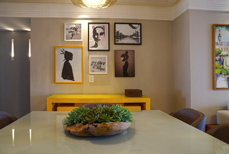 Yellow: Salas de jantar  por Ju Nejaim Arquitetura