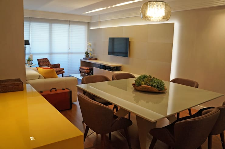 Yellow: Salas de jantar  por Ju Nejaim Arquitetura,Moderno