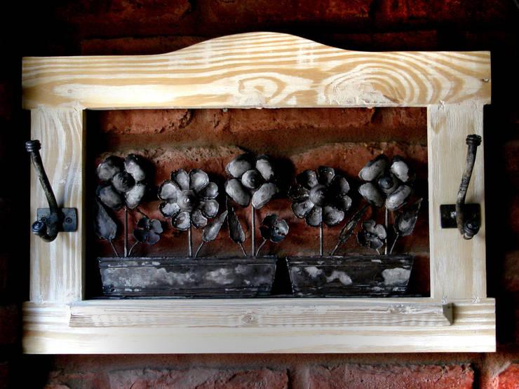 Potpourri elementos de decoración: Hogar de estilo  por Nino Decoraciones