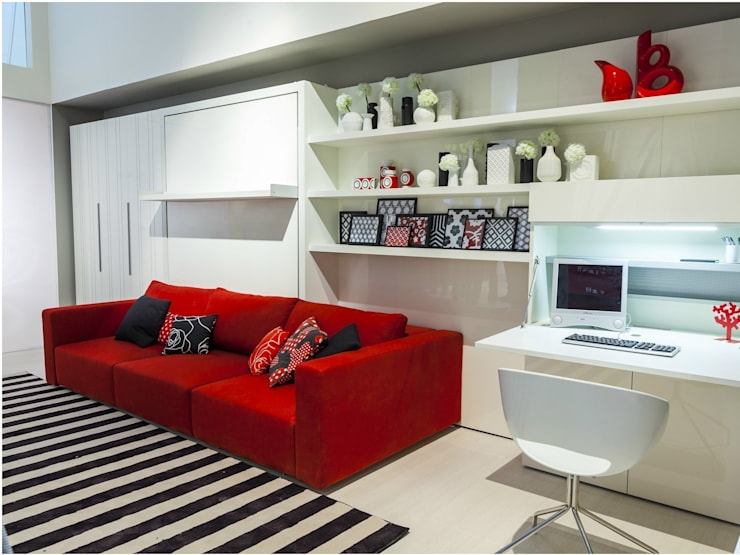 Cama abatible con sofá : Salones de estilo  de Mobiliario Xikara