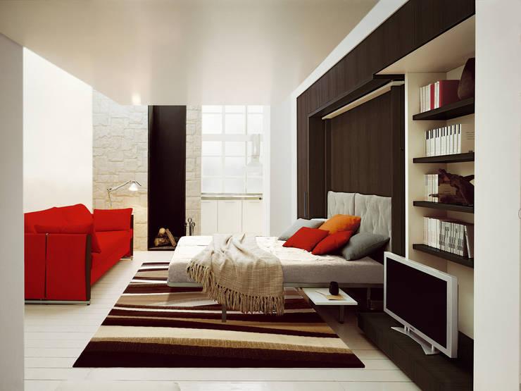 Como adaptar una cama en un salón : Salones de estilo  de Mobiliario Xikara