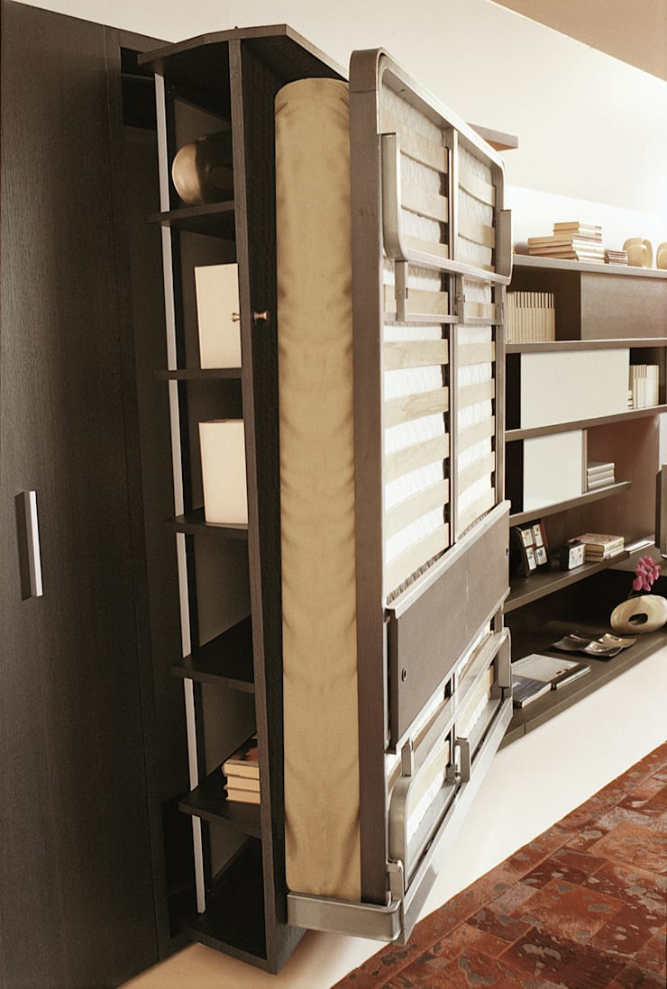 Cama abatible giratoria lgm: Salones de estilo  de Mobiliario Xikara