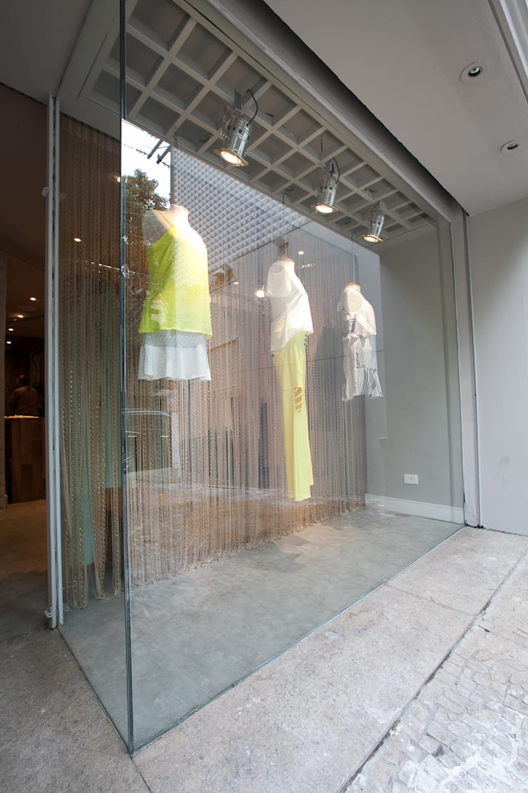 Vitrine : Lojas e imóveis comerciais  por Arquitetura Juliana Fabrizzi,