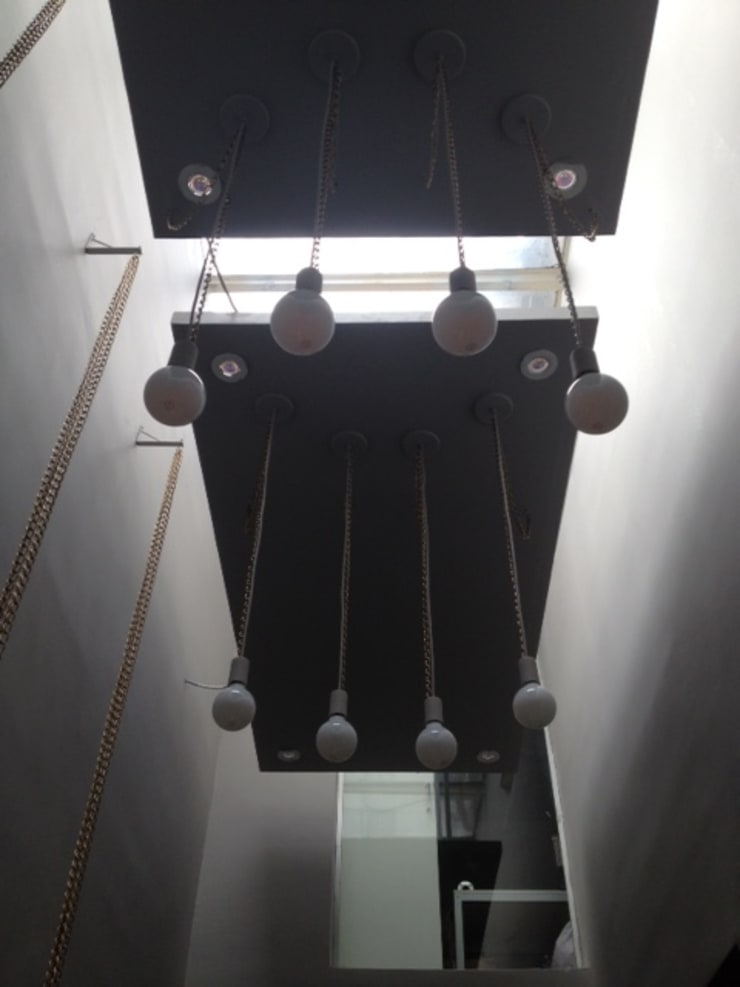 Detalhe iluminação : Lojas e imóveis comerciais  por Arquitetura Juliana Fabrizzi,
