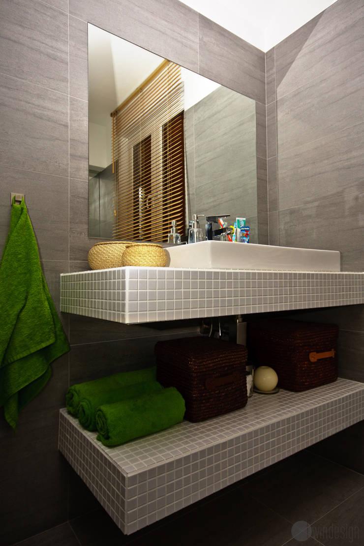 Szarość i limonka: styl , w kategorii Łazienka zaprojektowany przez Twindesign  - Kompleksowe Usługi Budowlane