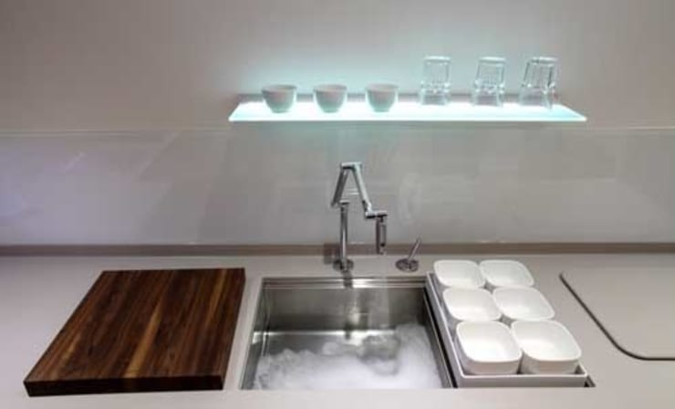 utility sink and modern tap:  Kitchen by John Ladbury and Company