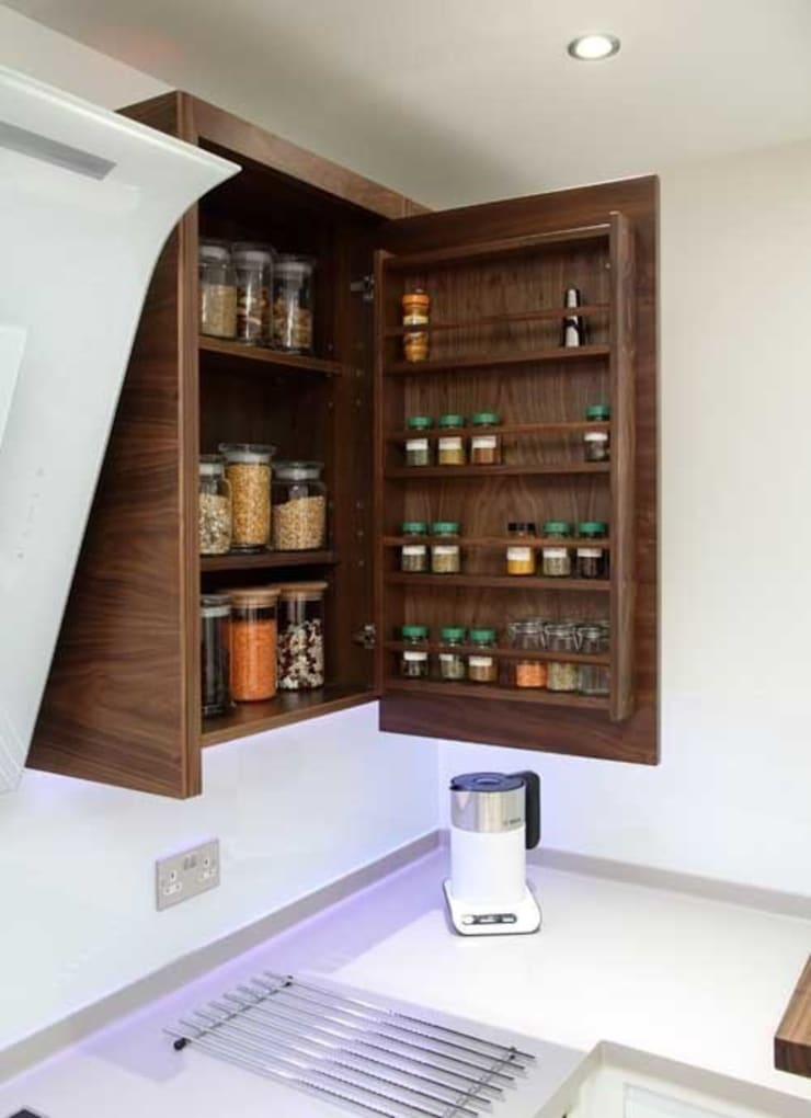 Spice and sundries cupboard:  Kitchen by John Ladbury and Company