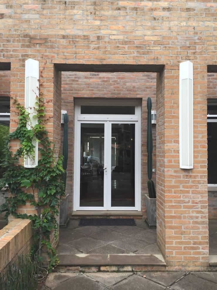 Residência LP: Casas  por Tellini Vontobel Arquitetura